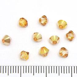 Swarovksi Xilion bicone 4 mm crystal metallic sunshine (klar med guldorange lyster på ena halvan)