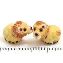 Lejon i keramik c:a 21 x 15 mm