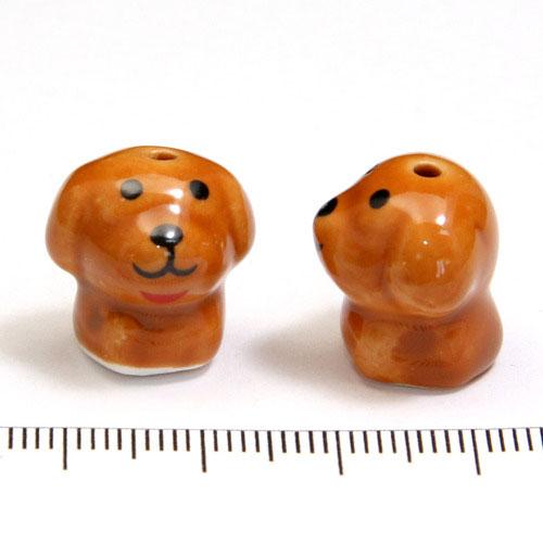 Ljusbrun hund i porslin c:a 16 mm - Utgående vara